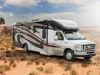 Winnebago Minnie Winnie 25B parked in the middle of a tumbleweed desert midday